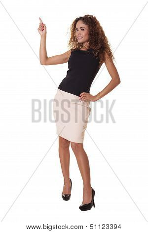 Composed Business Woman Points To Something Above.