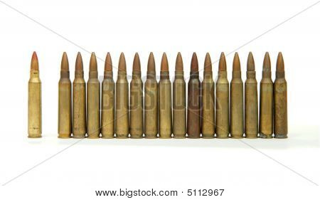 Row Of Standing M16 Rifle Cartridges Isolated