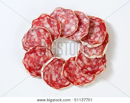 circle made from sliced salami poster