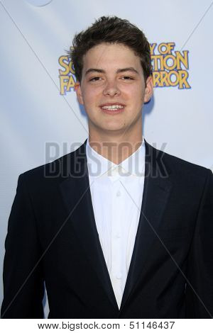LOS ANGELES - JUN 26:  Israel Broussard arrives at the 39th Annual Saturn Awards at the Castaways on June 26, 2013 in Burbank, CA