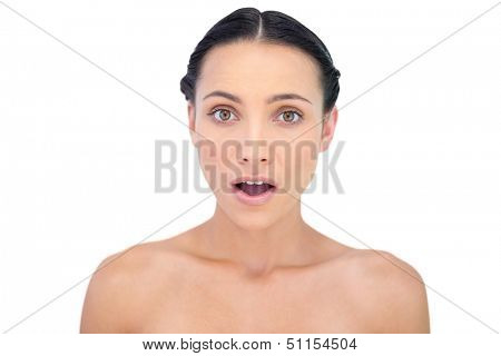 Astonished young model posing on white background