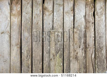 Old weather beaten wooden plank wall