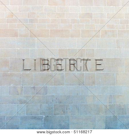 Liberte, the French word for freedom, carved on a wall