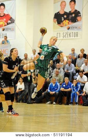 SIOFOK, HUNGARY - SEPTEMBER 14: Heidi Loke (green 5) in action at a Hungarian Championship handball match Siofok KC (black) vs. Gyori Audi ETO KC (green), September 14, 2013 in Siofok, Hungary.