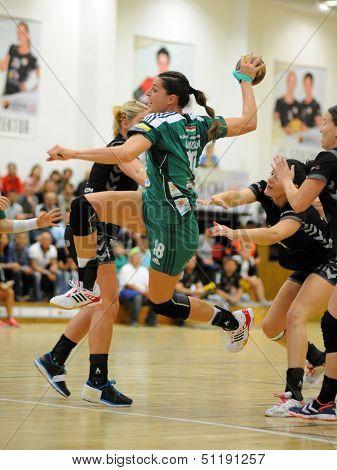 SIOFOK, HUNGARY - SEPTEMBER 14: Eduarda Amorim (in green) in action at a Hungarian National Championship handball match Siofok KC (black) vs. Gyor (green), September 14, 2013 in Siofok, Hungary.