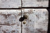 an old wooden and grungy locked door typical of the tuscany Italy poster