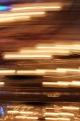 Abstract blur of lights across vertical shot. poster