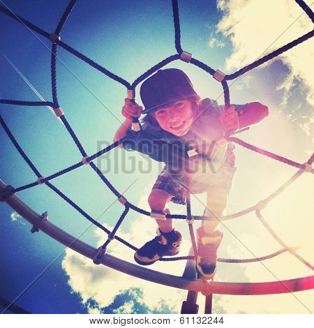 Boy playing at the park with instagram effect