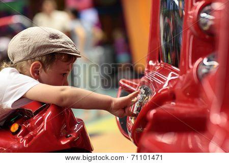 Kid Playing Arcade Game Machine