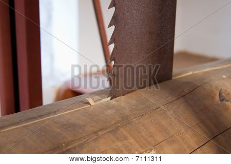 Close Up Of Saw Cutting Wood