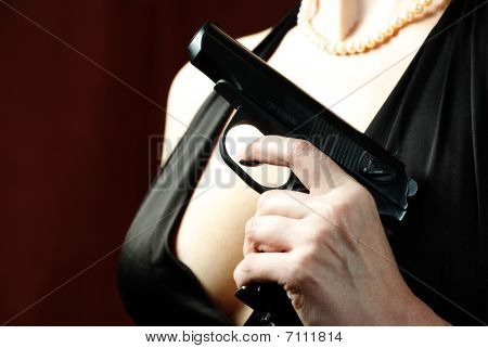 Beautiful and dangerous woman: gun breast pearls poster