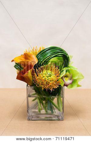 Floral Arangement With Calla Lilies, Cymbidium, Protea And Green