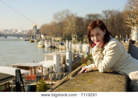 Calm Beautiful Woman In Paris In The Seine Embankment