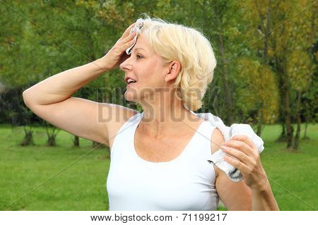 Older Woman Doing Sports With Towel