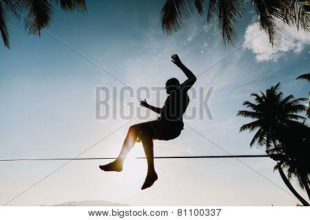 Teenage Jumping On Slackline