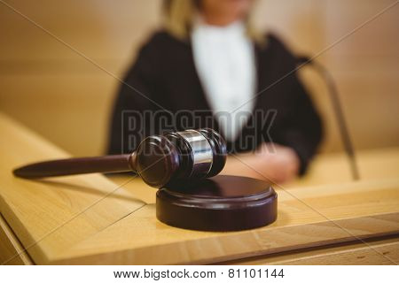 Gavel resting on sounding block in the court room