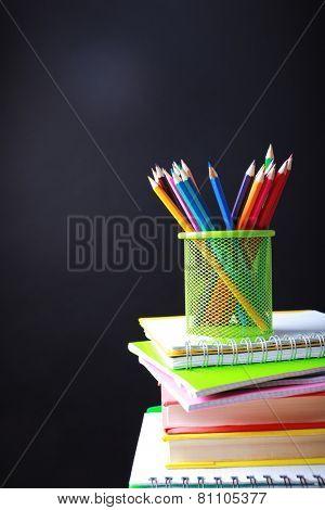 School supplies on black background