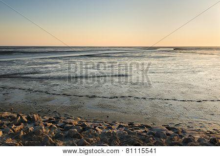 Mudflat Landscape At Sunset