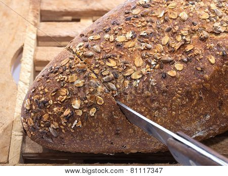 Knife Cutting Whole Grain Bread