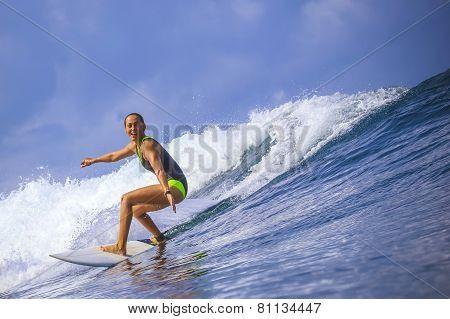 Surfer Girl On Amazing Blue Wave