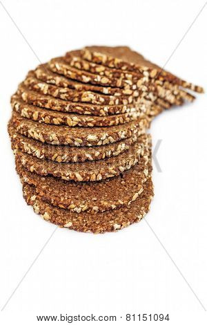 Slices of wholewheat bread isolated on white background
