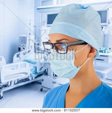 Female doctor in intensive care unit.