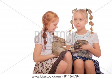 Little girls with a rabbits