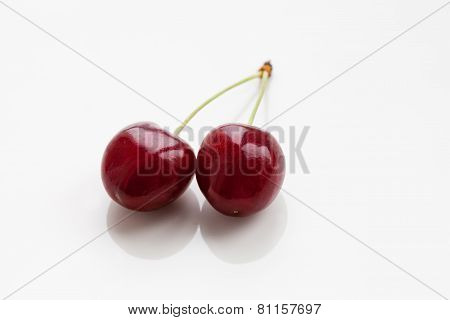 Two Berry Cherry Closeup. With Reflections. White Background. Stock Photo. (soft Focus).