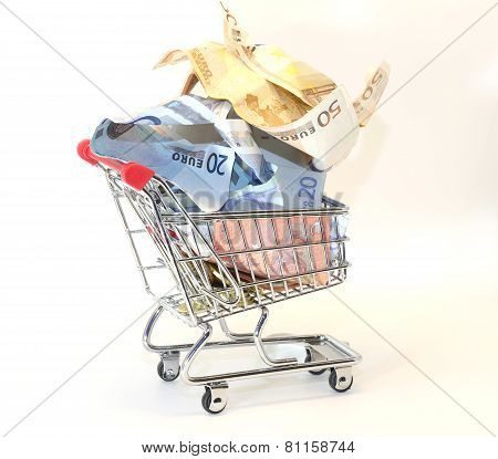 Shopping Cart Full Of Crumpled Banknotes