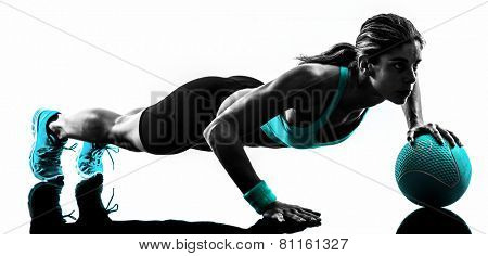 one caucasian woman exercising Medicine Ball  fitness in studio silhouette isolated on white background