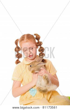 Little girl with  rabbit in her hands