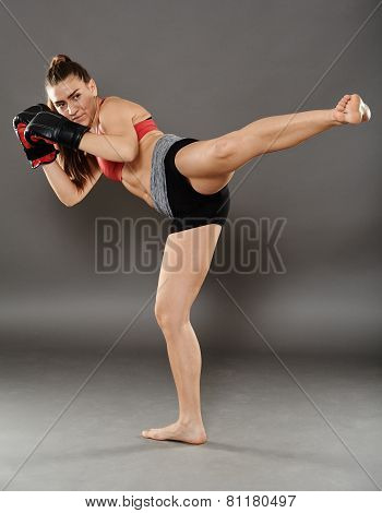 Kickbox Girl Delivering A Kick