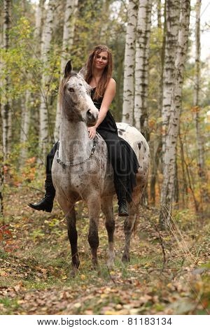 Young Girl With Appaloosa Horse In Autumn