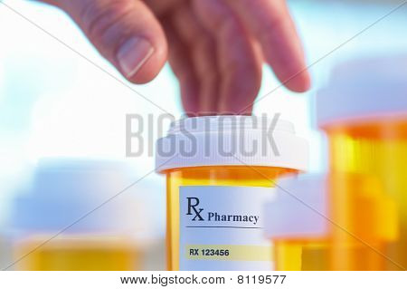 Prescription Bottle And Hand With Motion Blur