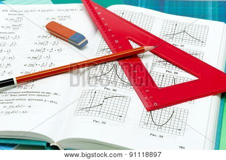 School Supplies And Textbooks On Mathematics Close Up