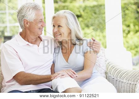 Senior Couple Relaxing In Chair