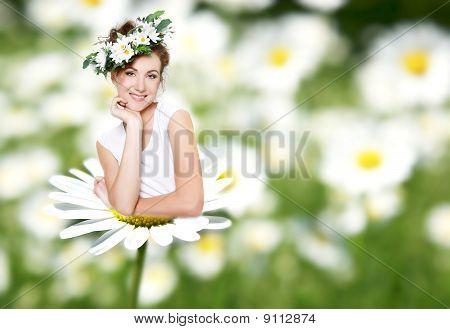 Beautiful Woman On Daisy Flower