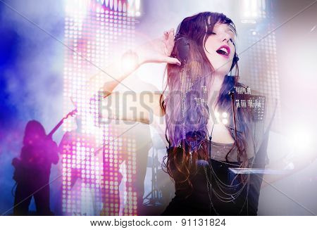 beautiful woman listening to music and singing.live music background