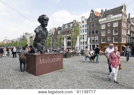 Statue Of Writer Multatuli On Bridge Over Singel In Amsterdam