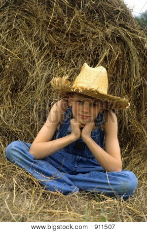 Boy By Hay Bale