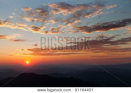 Beautiful Colorful Red Sunset On Mountains In The Evening