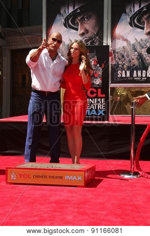 LOS ANGELES - MAY 19:  Dwayne Johnson, Lauren Hashian at the Dwayne Johnson Hand and Foot Print Ceremony at the TCL Chinese Theater on May 19, 2015 in Los Angeles, CA