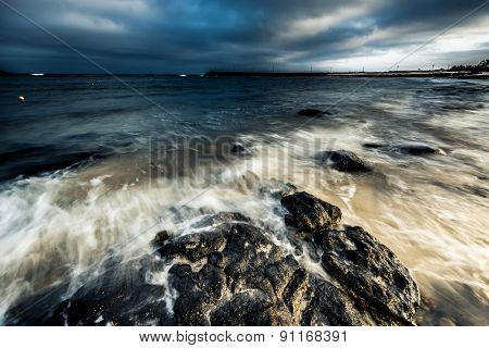 spellbinding dusk with dark blue sky at sea