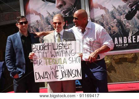 LOS ANGELES - MAY 19:  Brad Peyton, Dwayne Johnson, Toby Emmerich at the Dwayne Johnson Hand and Foot Print Ceremony at the TCL Chinese Theater on May 19, 2015 in Los Angeles, CA