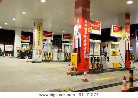 HONG KONG - APRIL 15, 2015: Shell fuel station at evening. Shell Oil Company is the United States-based subsidiary of Royal Dutch Shell
