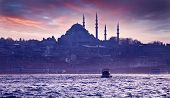 A boat trip on the Bosphorus at sunset. Istanbul at sunset. Evening Istanbul. Tourist trip in Turkey. poster