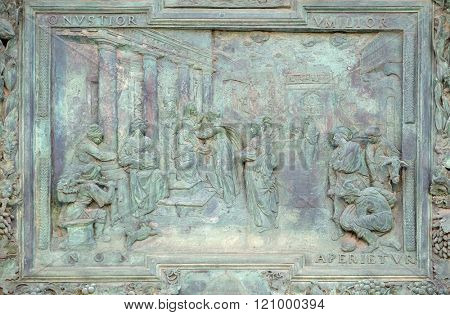PISA, ITALY - JUNE 06: Visitation of the Virgin Mary, detail of the central door of the Cathedral St. Mary of the Assumption in Pisa, Italy on June 06, 2015