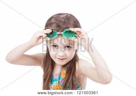 Portrait of child girl swimer isolated on white background