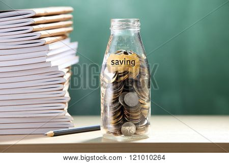 saving jar with coin for eduction