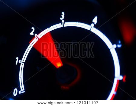 Tachometer Illuminated At Night
